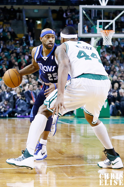 12 December 2012: Dallas Mavericks shooting guard Vince Carter (25) looks to pass the ball over Boston Celtics power forward Chris Wilcox (44) during the Boston Celtics 117-115 2 overtimes victory over the Dallas Mavericks at the TD Garden, Boston, Massachusetts, USA.