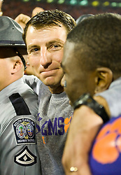 November 21, 2009; Clemson, SC, USA; Clemson Tigers head coach Dabo Swinney and wide receiver Jacoby Ford (6) after the game against the Virginia Cavaliers at Memorial Stadium.  Clemson defeated Virginia 34-21.