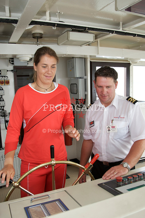 Liverpool, England - Sunday, June 10, 2007: Olga Savchuk take the wheel of the Royal Daffodil Mersey Ferry under the supervision of acting captain Robbie Quinn as she takes a cruise along Liverpool's famous River Mersey. The WTA tennis player is in the city for the Liverpool International Tennis Tournament which starts on Tuesday June 12th. For more information please visit www.liverpooltennis.co.uk. (Pic by David Rawcliffe/Propaganda)