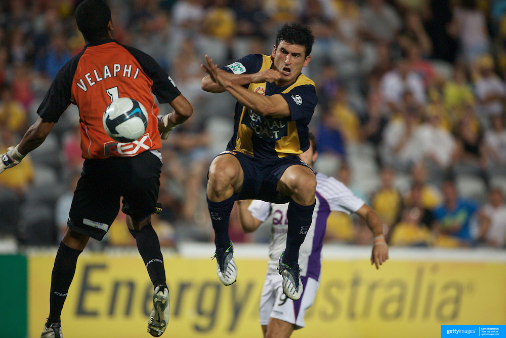 Nick Mrdja and Tando Velaphi collide during the Central Coast Mariners V Perth Glory A-League match at Gosford, New South Wales, Australia, on Friday, November 27, 2009. Photo Tim Clayton.
