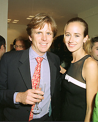 Restaurant owner MOGENS THOLSTRUP and LADY VICTORIA HERVEY at a party in London on 7th May 1997.LYE 7