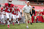 FAYETTEVILLE, AR - MARCH 6:   Head Coach Chad Morris of the Arkansas Razorbacks leads his team onto the field before the annual Spring Game at Razorback Stadium on March 6, 2019 in Fayetteville, Arkansas.  (Photo by Wesley Hitt/Getty Images) *** Local Caption *** Chad Morris