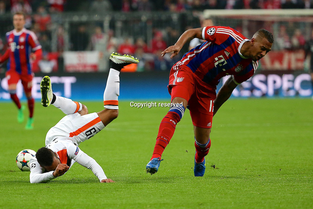 11.03.2015. Allianz Stadium, Munich, Germany. UEFA Champions League football. Bayern Munich versus Shakhtar Donetsk.  Jerome Boateng (Bayern) launches Alex Teixeira (Schachtar Donezk) over his shoulder The game ended 7-0 to Bayern over Shakhtar.