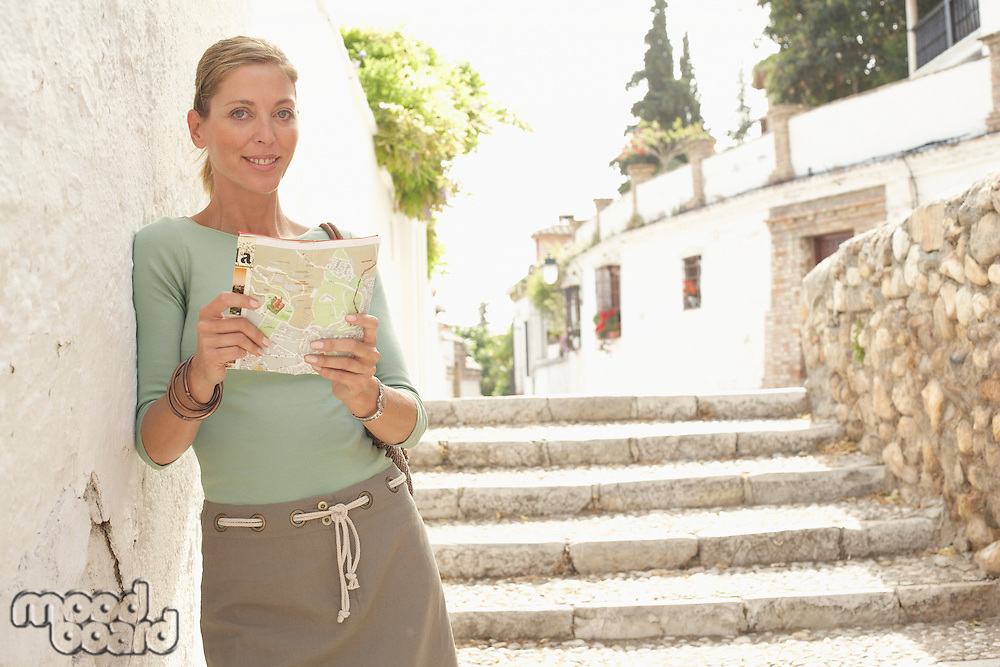 Woman with Guidebook in Street