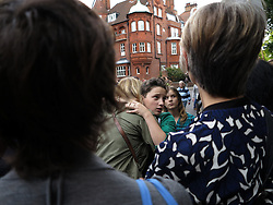 UK ENGLAND LONDON 5OCT13 - Joe Hewetson, son of detained activist Frank Hewetson is comforted during a demonstration outside the Russian embassy in London in support of 30 Greenpeace activists detained in Russia following a peaceful protest.<br /> <br /> jre/Photo by Jiri Rezac<br /> <br /> © Jiri Rezac 2013