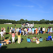 Spectators watch the presentation after the Airstream vs. Cinque Terre Polo match at the Greenwich Polo Club, Greenwich, Connecticut, USA. 23rd June 2013. Photo Tim Clayton