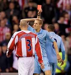 STOKE, ENGLAND - Sunday, October 19, 2008: Tottenham Hotspur's Michael Dawson looks dejected after being sent off during the Premiership match against Stoke City at the Britannia Stadium. (Photo by David Rawcliffe/Propaganda)