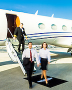 Executives exit a Gulfstream business jet at Opa-locka Executive Airport, near Miami.  Created as advertising for Phillips 66 Aviation Fuels.