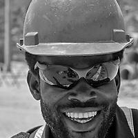 En una mega construccion son muchas las personas que trabajan y laboran en ella, pero son principalmente los obreros lo que realizan la mayor fuerza de trabajo. Varian de estado, pais, edad, pero todos realizan algo en comun, el trabajo duro a pleno sol en una obra tras obra. Es su forma de ganarse la vida, y quizas sea la unica que conocen. Son solo 36 retratos de muchos que laboran. Una pequeña muestra. Rasgos y miradas de una fuerza lab oral. In a mega construction are many people who work in it, but the workers are mainly what do most workforce. Vary from state, country, age, but they all perform something in common, hard work in the sun in construction after construction It's their way of living, and perhaps it is the only one known. It's only 36 portraits of many who work. A small sample. Features and looks of a workforce. La Guaira, 2013, 2014. Venezuela
