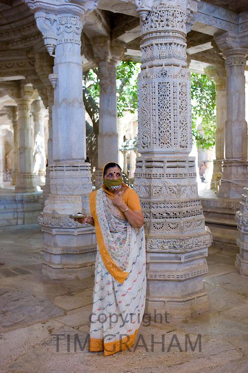 Jain pilgrim with traditional mask at The Ranakpur Jain Temple at Desuri Tehsil in Pali District, Rajasthan, India