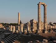Temple of Apollo in the evening sun, 4th century BC, Didyma, Aydin, Turkey. This enormous temple complex dates from the Archaic period, but after it was destroyed by Darius I of Persia in 494 BC, it was rebuilt in the Hellenistic style in 313 BC once Alexander the Great had conquered Miletus. It originally had 122 enormous 60-foot tall Ionic columns dating to the 2nd century BC, although only 3 remain, 2 of which support the roof of the cella or inner chamber of the temple. Didyma was an ancient Greek sanctuary on the coast of Ionia near Miletus, consisting of a temple complex and the oracle of Apollo, or Didymaion, who was visited by pilgrims from across the Greek world. The earliest temple ruins found here date to the 8th century BC but Didyma's heyday lasted throughout the Hellenistic age. It was approached along a 17km Sacred Way from Miletus and is the largest sanctuary in Western Turkey. Picture by Manuel Cohen
