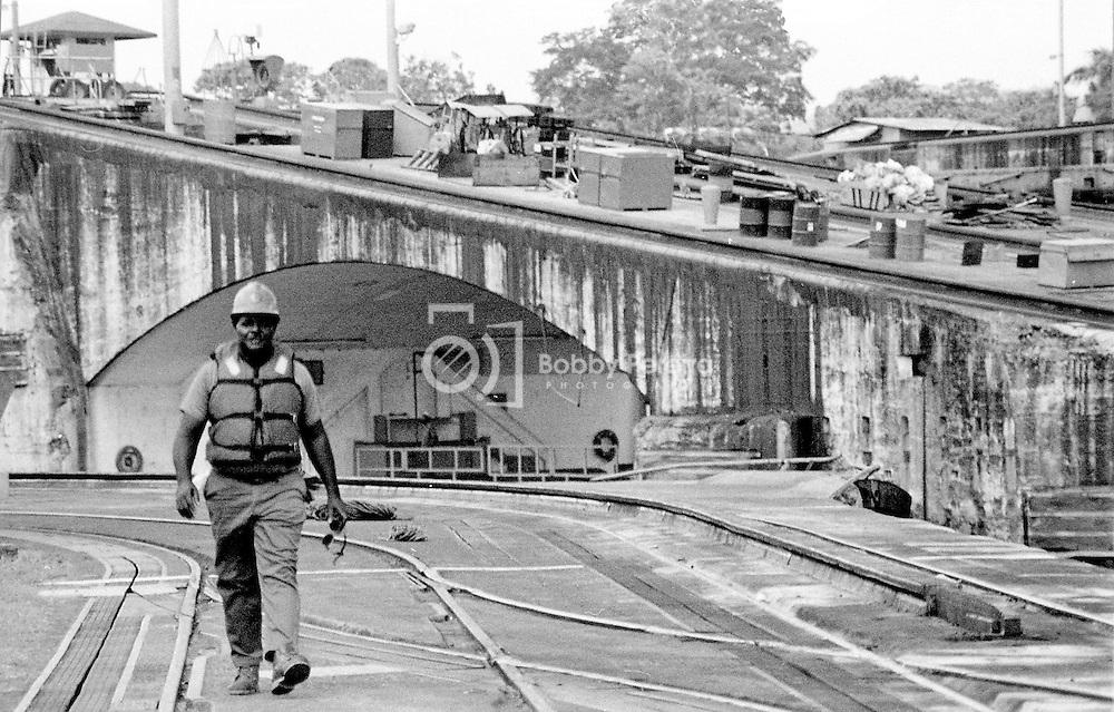 Panama Canal employee walking at the Miraflores Locks at the Panama Canal.