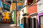 View of the colorful buildings a cobblestone street in the historic center of Guanajuato City, Guanajuato, Mexico.