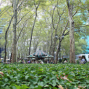 NEW YORK -SEPTEMBER 03: People enjoying at lunch time in Bryant Park on September 03, 2013 in New York City, NY. Bryant Park is a 9,603 acre privately managed park in the center of Manhattan
