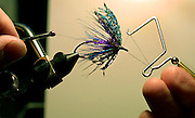 "Joel LaFolette is a champion fly fisherman who will demonstrate tying and talk about fishing at the upcoming Sportsmen's Show. He finishes tying his popular ""Royal Treatment"" lure."