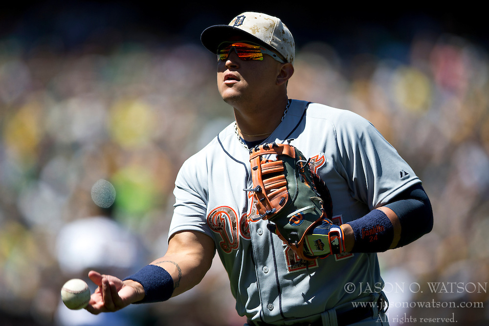 OAKLAND, CA - MAY 26:  Miguel Cabrera #24 of the Detroit Tigers tosses a baseball into the stands during the fifth inning against the Oakland Athletics at O.co Coliseum on May 26, 2014 in Oakland, California. The Oakland Athletics defeated the Detroit Tigers 10-0.  (Photo by Jason O. Watson/Getty Images) *** Local Caption *** Miguel Cabrera