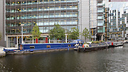 Canal Boats on Paddington Basin, London, UK. The basin was opened in 1801 and it is the terminus of the Paddington Arm of the Grand Junction Canal. Picture by Manuel Cohen