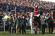 Winner of the 2019 Grand National Tiger Roll gets a nice cool bucket of water from jockey Davy Russell 5:15pm The Randox Health Grand National Steeple Chase (Grade 3) 4m 2f during the Grand National Meeting at Aintree, Liverpool, United Kingdom on 6 April 2019.