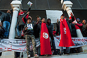 Tunisians protest under the building of governement demanding the dissolution of the new interim governement.