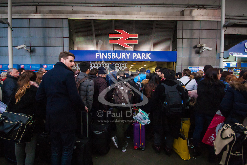Finnsbury Park, London, December 27th 2014. All trains in and out of King's Cross, one of the busiest stations in London, have been cancelled thanks to engineering work on the East Coast mainline overrunning. A limited sevice is running from Finnsbury Park station which has become heavily congested, with British Transport Police called in to assist with crowd control. PICTURED: Almost thgere! limited numbers of passengers are admitted to Finnsbury Park station as staff try to control the overcrowding of platforms.