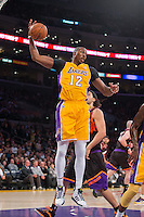 12 February 2013: Center (12) Dwight Howard of the Los Angeles Lakers grabs a rebound against the Phoenix Suns during the first half of the Lakers 91-85 victory over the Suns at the STAPLES Center in Los Angeles, CA.