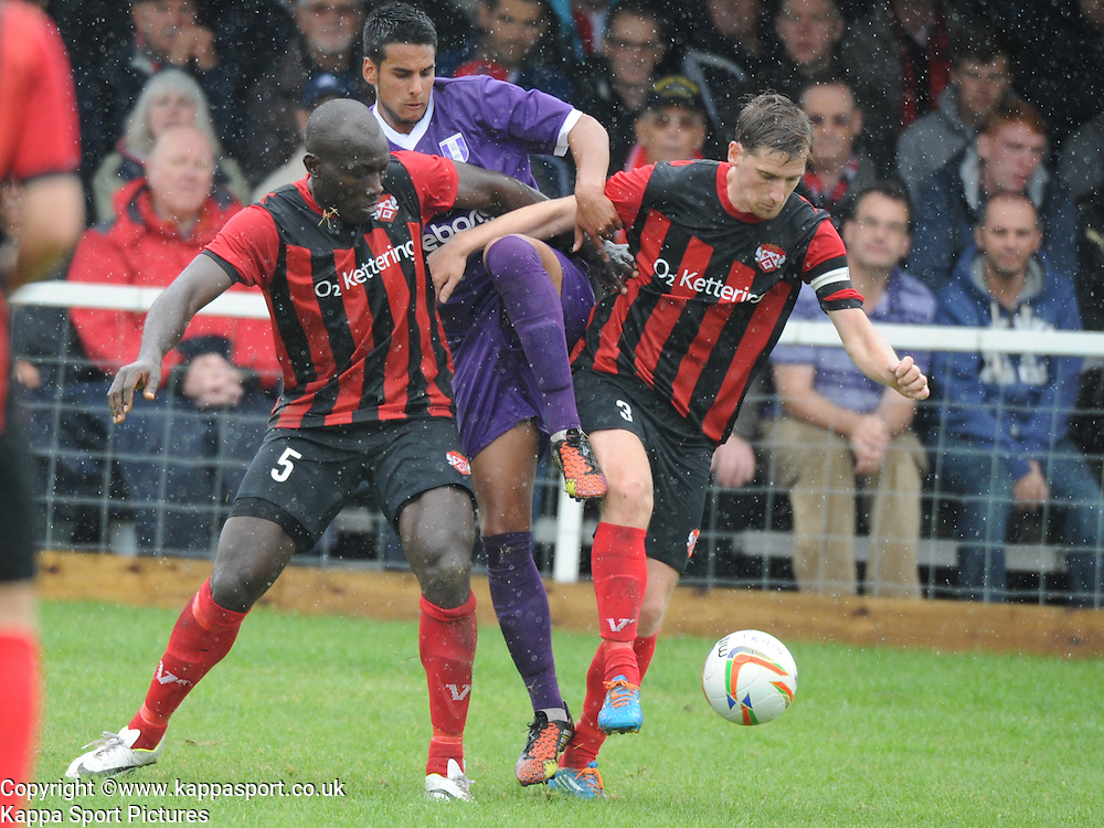 Kettering Henry Eze, and Skipper Steven Kinniburgh, hold of Daventrys attack, Kettering Town v Daventry Town Southern League Division One Central, 25th August 2014