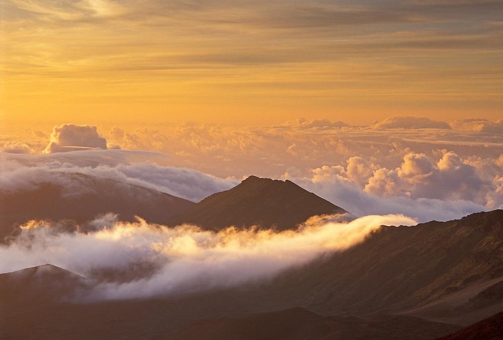 Clouds and crater rim at sunrise, Haleakala National Park; Maui; Hawaii.