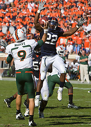 Virginia wide receiver Staton Jobe (22) puts pressure on Miami (FL) quarterback Robert Marve (9).  The Miami Hurricanes defeated the Virginia Cavaliers 24-17 in overtime in a NCAA Division 1 Football game at Scott Stadium on the Grounds of the University of Virginia in Charlottesville, VA on November 1, 2008.