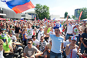 Hundreds of Slovenian football fans cheering in a support of its national team playing against favorites in group C, England. Fans gathered in the capital city at the fair centre in front of a big screen..Ljubjana, Slovenia. 23/06/2010.