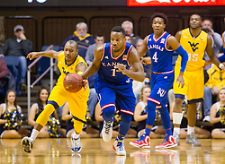 Jan 12, 2016; Morgantown, WV, USA; West Virginia Mountaineers guard Jevon Carter (2) steals the ball from Kansas Jayhawks guard Wayne Selden Jr. (1) during the first half at the WVU Coliseum. Mandatory Credit: Ben Queen-USA TODAY Sports