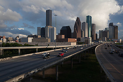 Houston, Texas skyline and freeways with traffic in foreground.