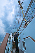 "Captain Axel Rittig phoning home from aboard the ""Lili Marleen"" (luxurious sailing ship of Deilmann Cruises)."
