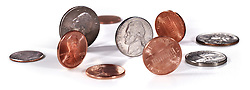 pennies, nickels, dimes, quarters on white