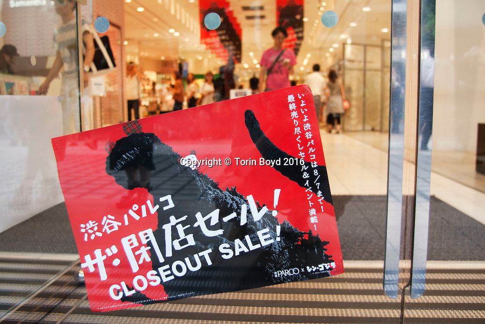 July 24, 2016, Tokyo, Japan: This is Shibuya Parco Store, a Tokyo fashion landmark located in Shibiya district which will close in August 2016 and slated for demolition and rebuild in 2017. Leading up to the closing, this mall like complex that houses several floors of boutiques and designer outlets is having an all-store Godzilla themed sale in which all shops are offering a 50% discount sale. This event includes motifs and imagery of Godzilla throughout the entire mall. (Torin Boyd/Polaris).