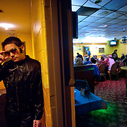 Fourteen-year-old Elvis impersonator Taylor Rodriguez waits for his cue to perform at his parent's restaurant El Cazador in Bedford, Va.