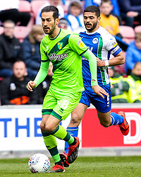 Mario Vrancic of Norwich City goes past Sam Morsy of Wigan Athletic - Mandatory by-line: Robbie Stephenson/JMP - 14/04/2019 - FOOTBALL - DW Stadium - Wigan, England - Wigan Athletic v Norwich City - Sky Bet Championship