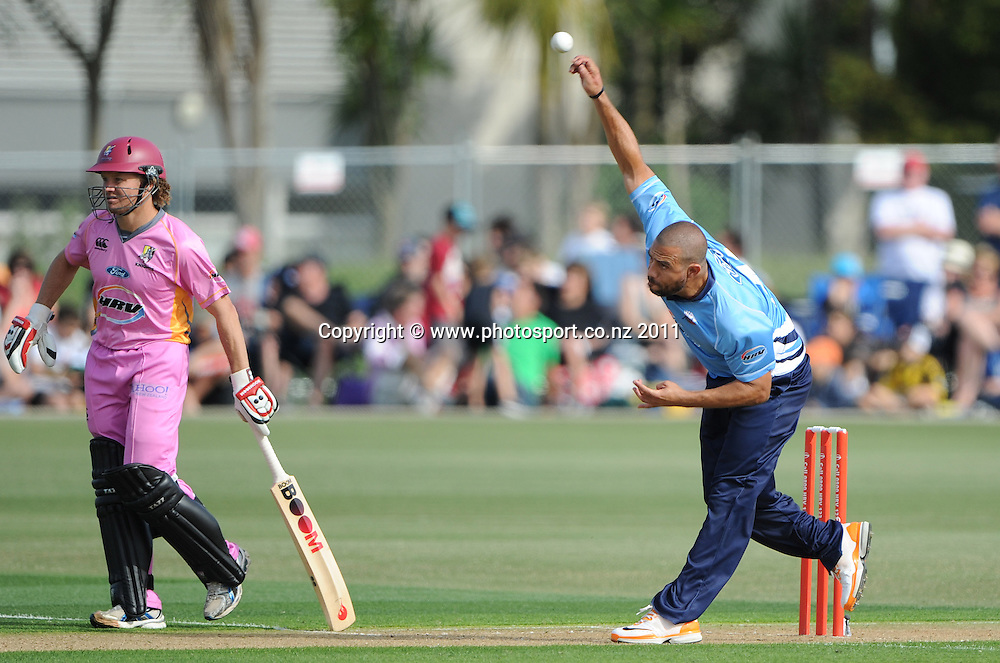 Andre Adams bowls as Hamish Marshall backs up during the HRV Twenty20 Cricket match between the Auckland Aces and Northern Knights at Colin Maiden Oval in Auckland on Monday 26 December 2011. Photo: Andrew Cornaga/Photosport.co.nz