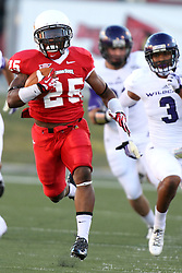 21 September 2013:  Marshaun Coprich runs almost coast to coast and even crosses the finish line, but the ball is brought back for offensive holding during an NCAA football game between the Abilene Christian Wildcats and the Illinois State Redbirds at Hancock Stadium in Normal IL