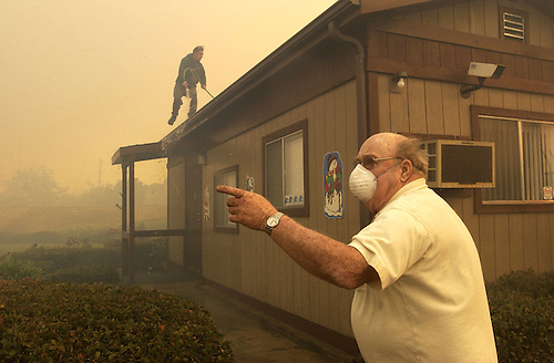 Moorpark Self Storage Manager Herbe Clerq, Right, Points Towards Flames  Across The Street.