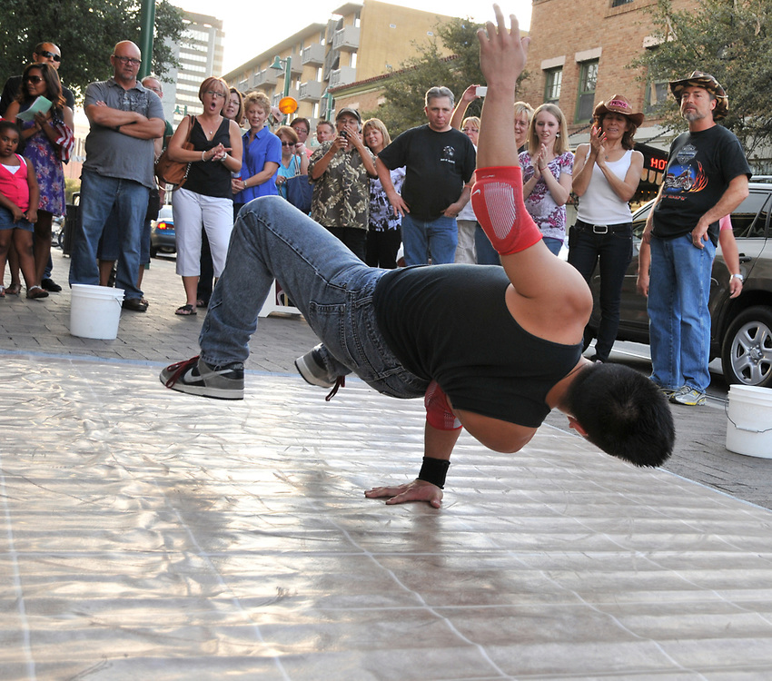 Les Avenge, an acrobatic troupe, performs at 2nd Saturdays Downtown in Tucson, Arizona.