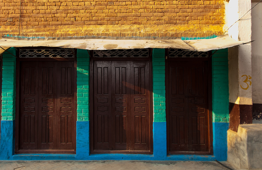 3 doors in Tansen, Nepal bathed in afternoon light