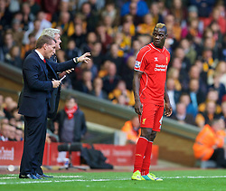 25.10.2014, Anfield, Liverpool, ENG, Premier League, FC Liverpool vs Hull City, 9. Runde, im Bild Liverpool's manager Brendan Rodgers and Mario Balotelli against Hull City // during the English Premier League 9th round match between Liverpool FC and Hull City at the Anfield in Liverpool, Great Britain on 2014/10/25. EXPA Pictures © 2014, PhotoCredit: EXPA/ Propagandaphoto/ David Rawcliffe<br /> <br /> *****ATTENTION - OUT of ENG, GBR*****