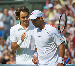 LONDON, ENGLAND - Monday, June 21, 2010: Roger Federer (SUI) and Alejandro Falla (COL) after the Gentleman's Singles 1st Round on day one of the Wimbledon Lawn Tennis Championships at the All England Lawn Tennis and Croquet Club. (Pic by David Rawcliffe/Propaganda)