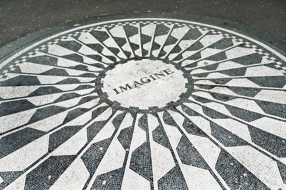 "John Lennon's ""Imagine"" circle, created out of small tiles, in Strawberry Fields which is located Central Park New York City, NY."