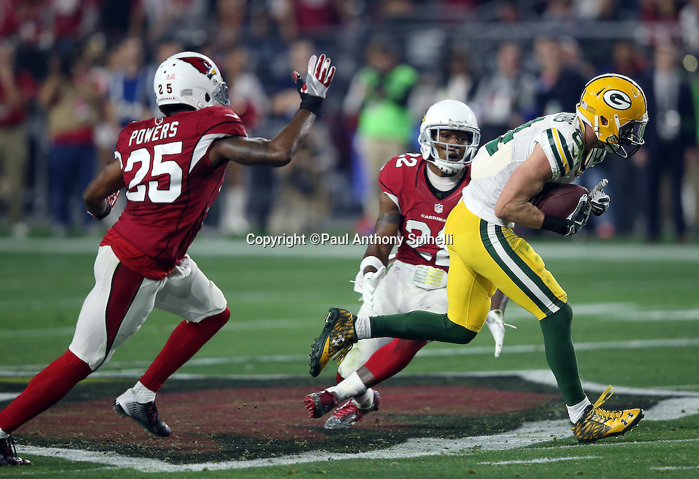 Arizona Cardinals strong safety Tony Jefferson (22) and Arizona Cardinals cornerback Jerraud Powers (25) chase Green Bay Packers wide receiver Jeff Janis (83) on a second quarter pass reception good for a first down during the NFL NFC Divisional round playoff football game against the Arizona Cardinals on Saturday, Jan. 16, 2016 in Glendale, Ariz. The Cardinals won the game in overtime 26-20. (©Paul Anthony Spinelli)