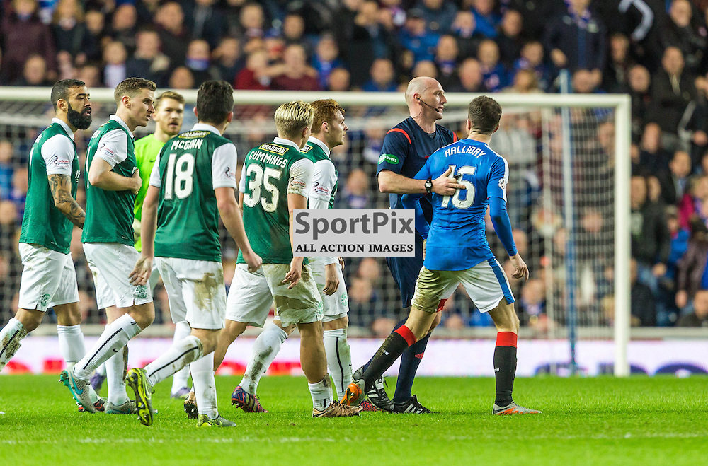 Andrew Halliday (16) is escorted from the pitch by referee  Bobby Madden during the match between Rangers and Hibernian (c) ROSS EAGLESHAM | Sportpix.co.uk