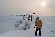 Alaska. The Trans-Alaska pipeline exits Pump Station 1 at Prudhoe Bay on its 800 mile journey to Valdez. MR.