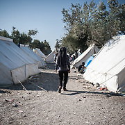 A refugee walks in the Kara Tepe camp
