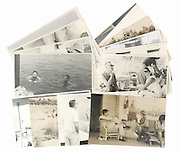 Never-before-seen photos of John F. Kennedy and wife Jackie vacationing with friends in Cape Cod set to go up for auction<br /> <br /> A set of rare photographs which show former US President John F. Kennedy and his wife Jackie relaxing on vacation in Cape Cod will go up for auction later this month.<br /> The candid images were taken by Washington Post heiress Katharine Graham at Listerine heiress Rachel 'Bunny' Mellon's Cape Cod beach shack in August 1961, just two years before JFK's assassination and show the couple enjoying a laid-back holiday in the company of some of their closest friends and family, including Mrs Mellon and her banker husband Paul.<br /> In one series of photos, JFK can be seen eating a relaxed meal outside on the deck, while deep in conversation with his host Mrs Mellon. His wife is pictured just a few meters away, seated alongside Mr Mellon.<br /> Another set of images, which will be auctioned off by RR Auction House on February 19, shows the then-44-year-old former President enjoying a swim in the bay alongside a male companion, before climbing up out of the water and onto what appears to be a dock, while reaching for a towel.<br /> None of the images seem to show JFK wearing his back brace, which was designed to help alleviate his chronic back pain - and which he is believed to have been wearing on the day of his death.<br /> Meanwhile, a usually-immaculate Jackie can be seen looking carefree and relaxed, wearing a casual collection of beachwear - a far cry from the high-end fashions she was usually pictured in.<br /> One image shows her enjoying a cigarette, while deep in discussion with a male friend. <br /> In October last year, a set of 13 wedding negatives from the Kennedys' spectacular wedding ceremony and celebration fetched $34,000 at auction, while in 2013, a Polaroid picture depicting the exact moment in which JFK was shot went under the hammer in Cincinnati.<br /> Surprisingly, the image, which was predicted to sell for up to $75,000 failed to attract a buyer, but is believed to have la