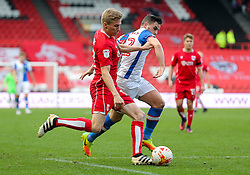 Taylor Moore of Bristol City vies with Craig Conway of Blackburn Rovers - Rogan Thomson/JMP - 22/10/2016 - FOOTBALL - Ashton Gate Stadium - Bristol, England - Bristol City v Blackburn Rovers - Sky Bet EFL Championship.